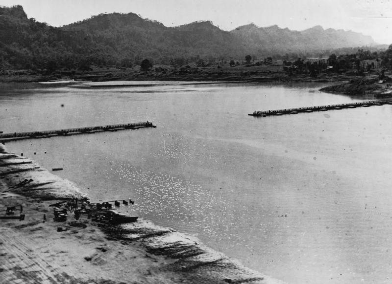 A view of the 1,100ft bailey bridge across the Chindwin River as it nears completion, less than 12 hours after the 14th Army captured Kalewa, 2 December 1944. © IWM (SE 835)