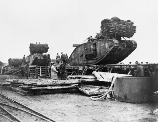 British Mark IV Female Tanks being loaded aboard railway trucks at Plateau Station in preparation for the Battle of Cambrai. IWM