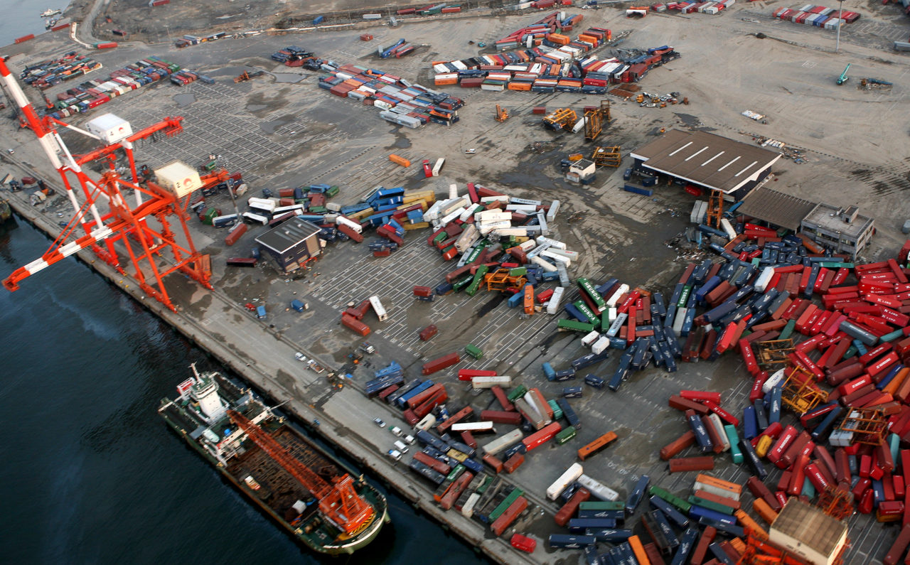 HONSHU, Japan - Shipping containers remain scattered