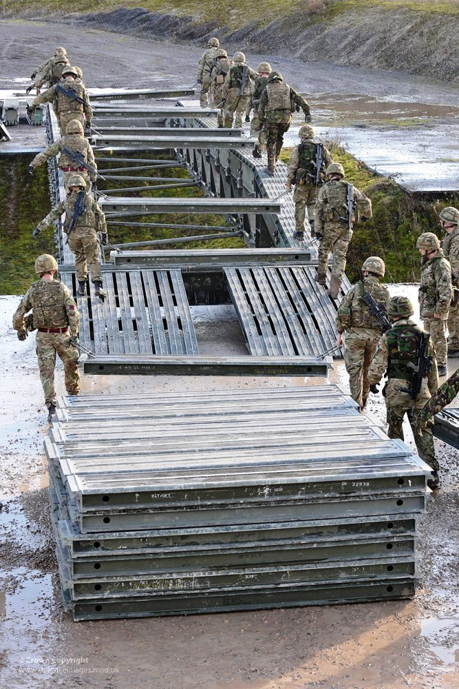 Soldiers from 26 Engineer Regiment Building Bridges
