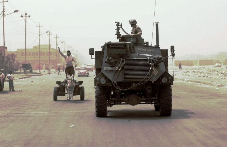 Pictured here is a Saxon armoured personnel vehicle of 1st Battalion of the Queens Lancashire Regiment as it carries out a routine patrol of Al Hayyaniya. A Shia flat area of Al Basrah city in the south of Iraq. To maintain law and order and improve relationships between the local community and our forces. 2003/07/30