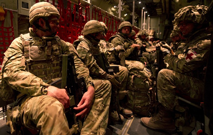 British military personnel are pictured leaving Camp Bastion for the final time in the back of a RAF Hercules transporter aircraft.